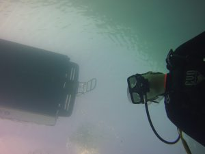 Diver under our boat Diversity showing water clarity during dive in Key Largo during January