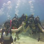 4 student divers having a great time