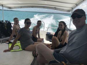 Happy SCUBA divers on boat