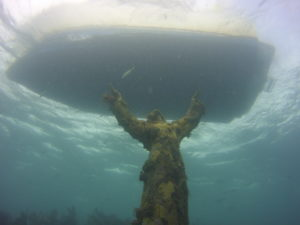 The statue of christ under the Island Ventures boat